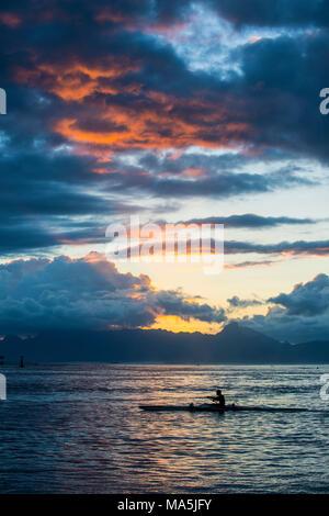 Dramatic sunset over Moorea ,Papeete, Tahiti, French Polynesia - Stock Photo