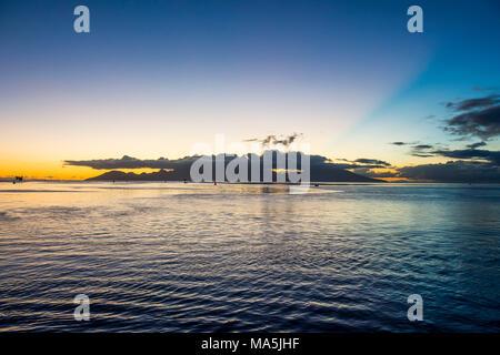 Moorea at sunset, Papeete, Tahiti, French Polynesia - Stock Photo