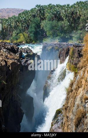 Epupa Falls on the Kunene River on the border between Angola and Namibia, Namibia - Stock Photo