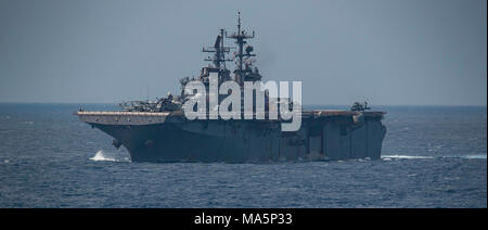 180329-N-BD308-0003 PHILIPPINE SEA (March 29, 2018) The Wasp-class amphibious assault ship USS Bonhomme Richard (LHD 6) transits the Philippine Sea prior to conducting a replenishment-at-sea with the fleet replenishment oiler USNS Tippecanoe (T-AO 199). Bonhomme Richard, along with the Wasp Expeditionary Strike Group, with embarked 31st Marine Expeditionary Unit, is operating in the Indo-Pacific region to enhance interoperability with partners, serve as a ready-response force for any type of contingency and advance the Up-Gunned ESG Concept. (U.S. Navy photo by Mass Communication Specialist 3r - Stock Photo