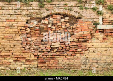 Bad repair of broken brick wall - Stock Photo