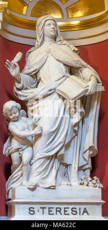 LONDON, GREAT BRITAIN - SEPTEMBER 13, 2017: The marble statue of St. Theresia of Avila in church Brompton Oratory (Immaculate heart of Mary) by unknow - Stock Photo