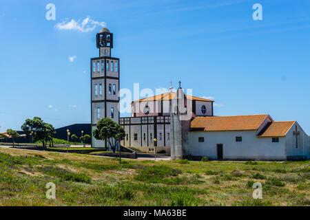 Sand dunes and Church at Costa Nova, a famous beach near Aveiro, Centro, Portugal - Stock Photo