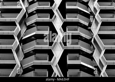Front view of abstract geometric design of a modern multi-story car park in  the Financial District, Singapore with strong symmetry and bold geometry