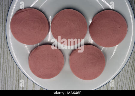 circle made from slices of salami - Stock Photo