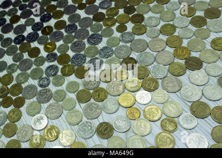 Many coins scattered on a floor, photo of - Stock Photo