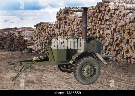 field military kitchen and plenty of firewood in the background - Stock Photo