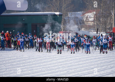 Russia Berezniki March 11, 2018: mass start in women's and men's Skiathlon at the winter Olympic games . - Stock Photo