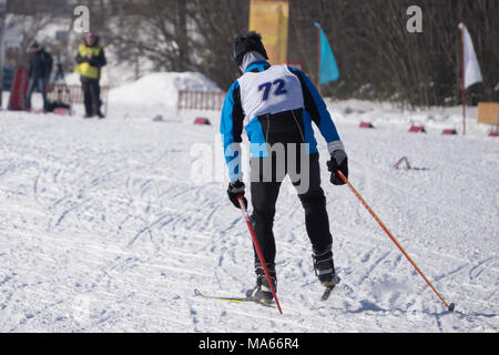 closeup of a male athlete skier during the race Les classic style in the championship - Stock Photo