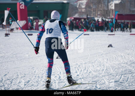 the rivalry between the women skiers race a classic style in winter during the world Cup - Stock Photo