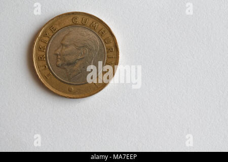 One Turkish coin denomination is 1 lira lie on isolated white background - back side - Stock Photo