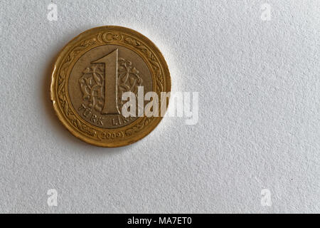 One Turkish coin denomination is 1 lira lie on isolated white background - Stock Photo