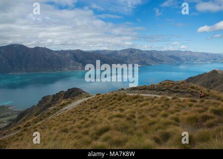 Azure Lake Hawea seen from the Isthmus Peak Track near Wanaka, Otago, New Zealand - Stock Photo