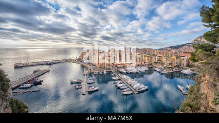 Aerial panorama of Fontvieille district and harbor in Monaco - Stock Photo