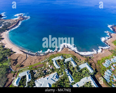 An aerial view of the golden beach and palm tree's at Hulopo'e Beach Park, and the Four Seasons resort at Manele Bay, Lanai Island, Hawaii, USA. - Stock Photo