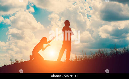 Couple silhouette breaking up a relation - Stock Photo