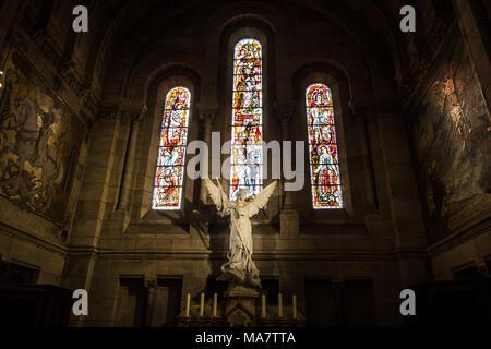 White Statue of Saint Michael inside the Basilica of the Sacred Heart (Basilique du Sacré Coeur) Paris - Stock Photo