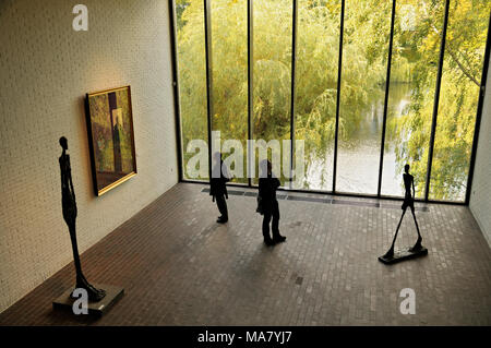 Visitors and sculptures from Alberto Giacometti at Louisiana Museum of Modern Art, Humlebæk, Denmark - Stock Photo