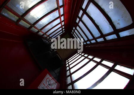 UK Red Telephone Box from the inside looking up - Stock Photo