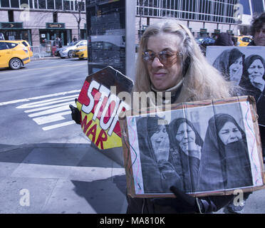 On the 15th Anniversary of the American war in Iraq peace activists critical of America's aggressive military actions around the world came to speak out against all US military aggression. New York City. - Stock Photo