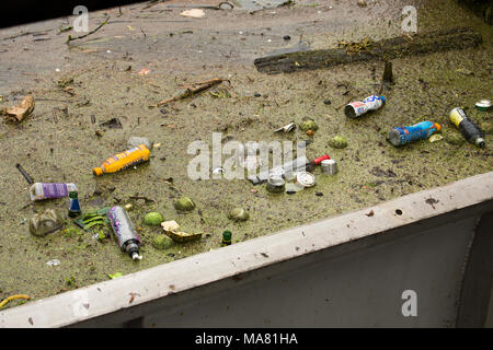 Plastic bottles, tennis balls and other rubbish accumulating about a sluice gate, River Avon Salisbury Wiltshire England UK - Stock Photo