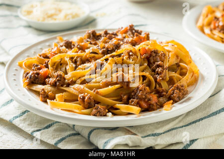 Homemade Italian Ragu Sauce and Pasta with Cheese - Stock Photo