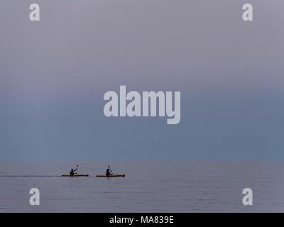 Kayakers in the water, Agawa Bay, Lake Superior Provincial Park, Ontario, Canada. - Stock Photo