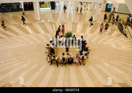 People sitting and wait at meeting point and people walking and use escalator for moving up and down for shopping at department store on May 23, 2017  - Stock Photo