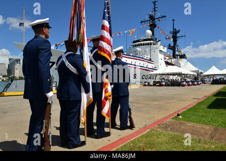 Members of the U.S. Coast Guard ceremonial honor guard stand in front of the Coast Guard Cutter Sherman prior to the cutter's decommissioning ceremony in Honolulu, Mar. 29, 2018. The Sherman was decommissioned after nearly 50 years of meritorious service to the United States. U.S. Coast Guard photo by Petty Officer 1st Class Matthew S. Masaschi. - Stock Photo