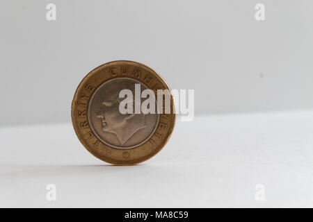Turkish coin lie on isolated white background Denomination is 1 lira - back side - Stock Photo
