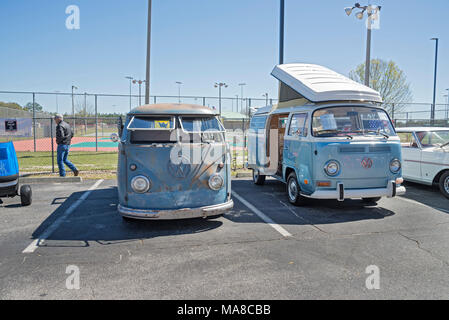 Car Show in Ft. White, Florida. Original Volkswagen vans, one original unrestored, and the other one restored is a 1972 camper van. - Stock Photo