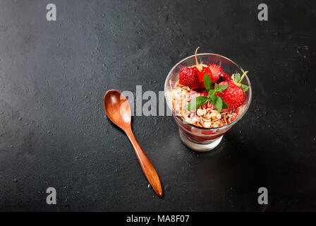 Healthy breakfast. Granola with  strawberry, honey, nuts, , fruit.Concept of a healthy eating. Top view, copy space - Stock Photo