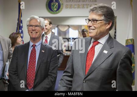 United States Department of Energy Secretary Rick Perry, standing right and slightly in the foreground, with Canada's Minister of Natural Resources, James Gordon Carr, March 30, 2017, image courtesy of the US Department of Energy, March 29, 2017. () - Stock Photo