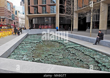 Business man sitting 'Forgotten Streams' sculpture by artist Cristina Iglesias at the Bloomberg European Headquarters City of London UK   KATHY DEWITT - Stock Photo