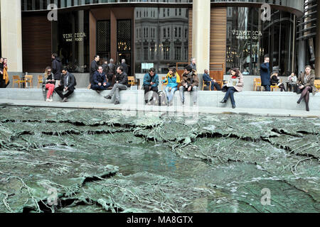 People sitting by 'Forgotten Streams' sculpture by artist Cristina Iglesias at the Bloomberg Headquarters building in City of London UK   KATHY DEWITT - Stock Photo