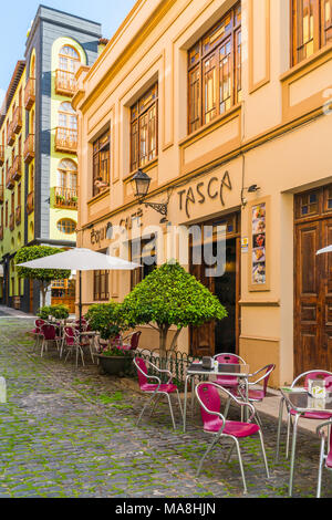 PUERTO DE LA CRUZ, TENERIFE - 20 MARCH 2018: Tables with chairs on the street outside of a small bar in one of Tenerife's top resorts, Puerto de la Cr - Stock Photo