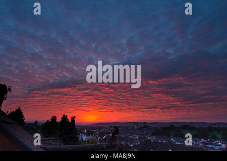 Bright red clouds and sky at sunset - Stock Photo