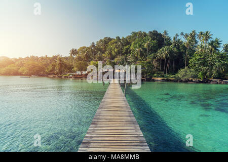 Wooden jetty towards a small island in summer sea at Phuket, Thailand. Summer, Vacation, Travel and Holiday concept. - Stock Photo