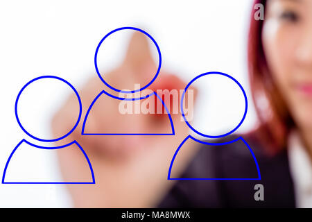 Asian businesswoman drawing networking icon graphics on virtual board - Stock Photo