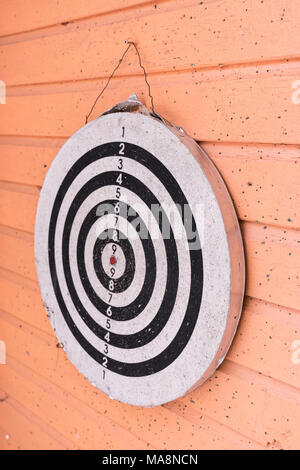 Old darts game on wooden wall - Stock Photo