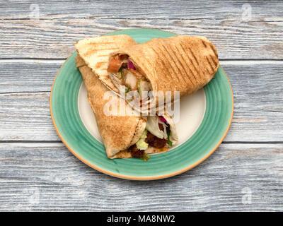 Jerk fried chicken wrap - Stock Photo