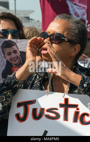 A woman shouts for justice for Jimmy Mubenga at the at Stop G4S protest outside G4S AGM at Excel London. - Stock Photo