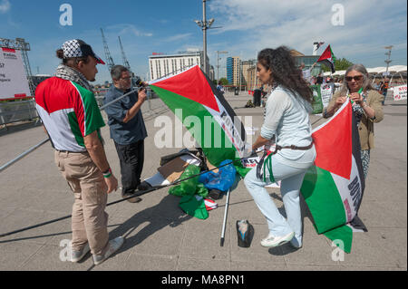 Inminds protesters get out more Palestinian flags at the Stop G4S protest outside G4S AGM at Excel London.  They have held regualr protests outside G4S's London offices for several years. - Stock Photo