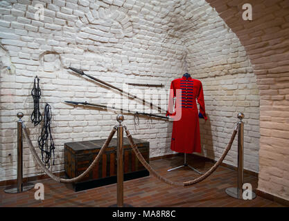Novozhivotinnoe, Russia - May 26, 2017: Ancient caftan, chest and weapons - Stock Photo