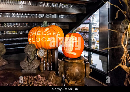 New York City, USA - October 30, 2017: Market food shop interior inside in downtown lower Chelsea neighborhood district Manhattan NYC, carved autumn - Stock Photo