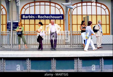 Paris, France: People on platform of Barbes Rochechouart Metro Station - Stock Photo