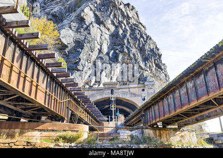 Harper's Ferry, USA - November 11, 2017: Empty railroad sign bridge tunnel entrance in fall autumn by small village town in West Virginia, WV - Stock Photo