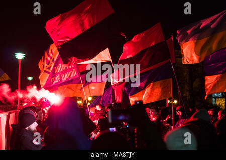 ODESSA, UKRAINE - January 30, 2018: People demonstrating civil peaceful protest during a state of armed revolution Ukraine. Movement of column of demonstrators at rally on the streets - Stock Photo