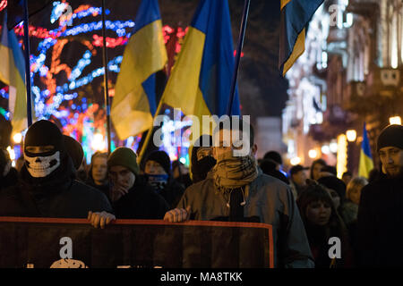 ODESSA, UKRAINE - January 30, 2018: People in Masks demonstrating civil peaceful protest during a state of armed revolution Ukraine. Movement of column of demonstrators at rally on the streets - Stock Photo