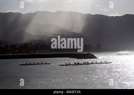 Outrigger canoes on the North Shore of Oahu near Haleiwa. - Stock Photo